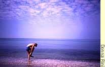 Mikkel wading in the ocean