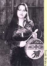 Abena Songbird in traditional dress with drum