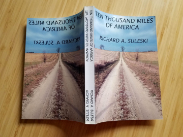Book cover with the back being a reverse image of the front. Ten Thousand Miles of America by Richard A Suleski