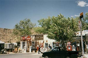 An old-fashioned gas station with colorful signs.