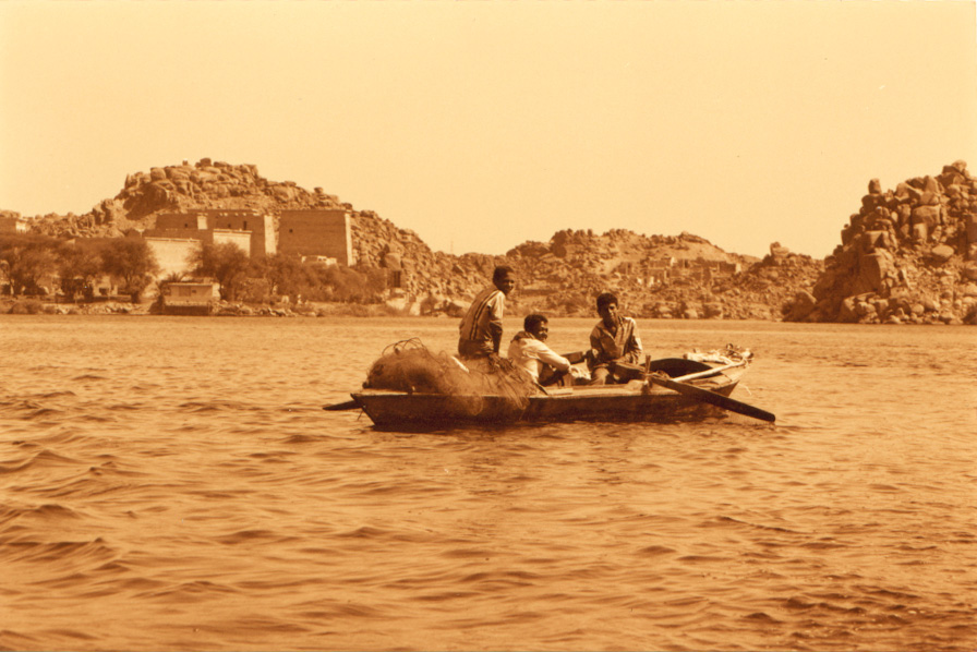 Three young fishermen rowing up the Nile