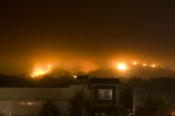 The glow of a fire at night on the hills over Santa Barbara