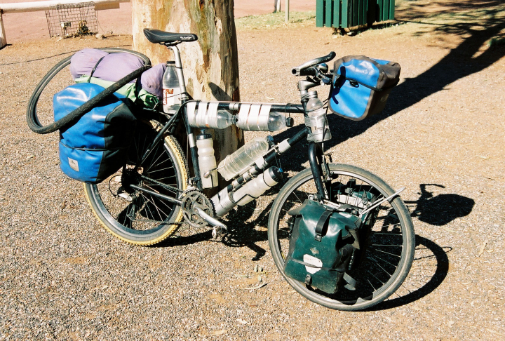 Fully-loaded touring bicycle ready to cross the Australian Outback