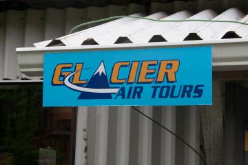 A sign for Glacier Air tours Squamish, British Columbia