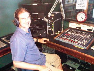 Scott Stoll sitting at the radio soundboard.