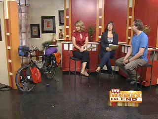 Scott with his bicycle on stage with the hosts of The Morning Blend