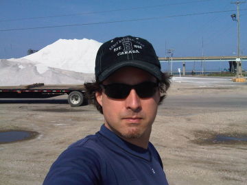 Scott standing in front of the salt piles at the Milwaukee Port