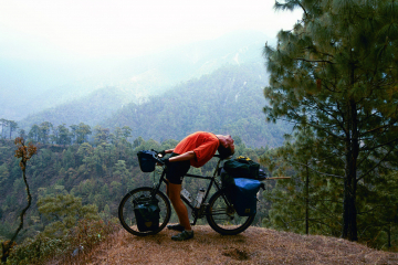Scott invents mountain-bicycle yoga in the Himalayas