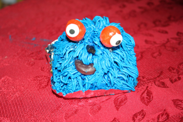 Grover Monster cupcake with blue fur and googly eyes.