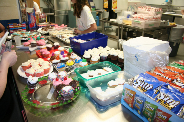 Hundreds of cupcakes are being prepared.