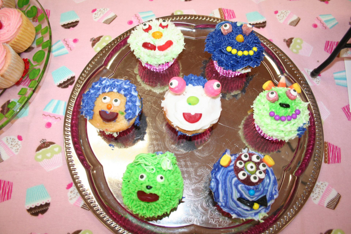 Monster cupcakes of all different colors and designs.