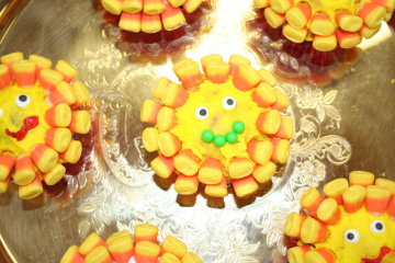Sunflower cupcakes made out of candy corn.
