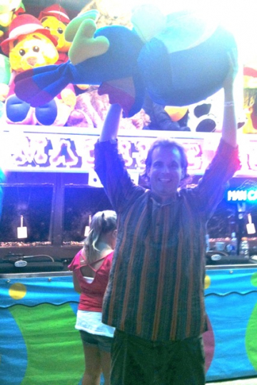 Scott winning a giant stuffed animal at the county fair