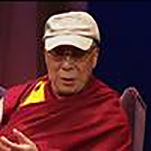 Dalai Lama wearing a baseball hat