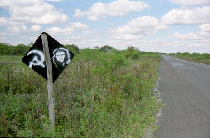 El Che Guevara and the hammer and sickle tastefully painted on the back of a road sign in Argentina