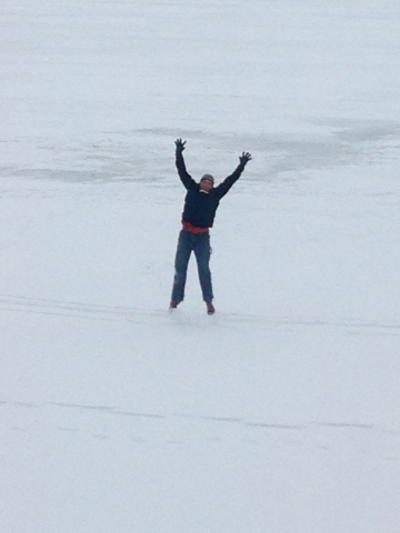 Scott doing jumping jacks on a frozen lake