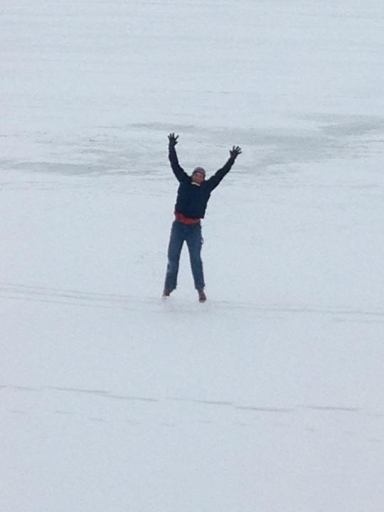 Scott doing jumping jacks on a frozen lake
