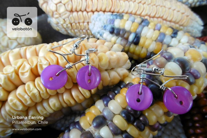 Martina Gee's Velobotóns Urbana Earring. Wire and purple buttons made into decorative bicycle-shaped earrings.