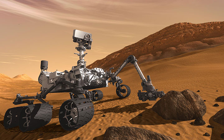 The Mars Science Laboratory Curiosity Rover artist's rendition of the rover on the red, sandy Mars surface investigating rocks.