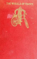 "An old copy of ""The wheels of change"" with red, canvas cover and gold emboss."