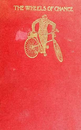 """An old copy of """"The wheels of change"""" with red, canvas cover and gold emboss."""