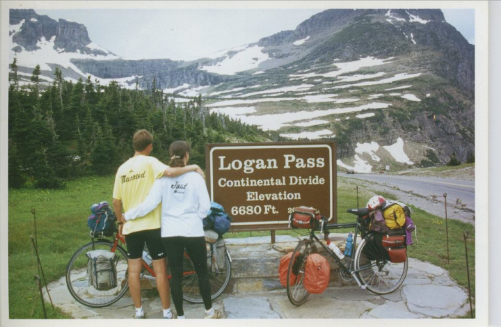 Rachel Hugens and Patrick. Just Married. Bike tour. Photo at Logan Pass Continental Divide.