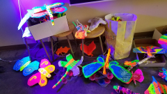 Monarch butterfly garden blacklight art show. Here are the pieces being assembled with the blacklight on.