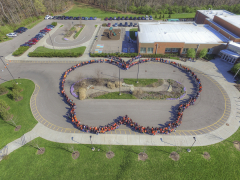 Monarch butterfly made of people school photo