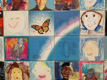 Parker Woods Montessori mural close up. Caterpillar dreaming of becoming a butterfly mini-story.