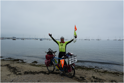 Frosty Wooldridge arrives at Atlantic Ocean during his Northern Tier bicycle tour.