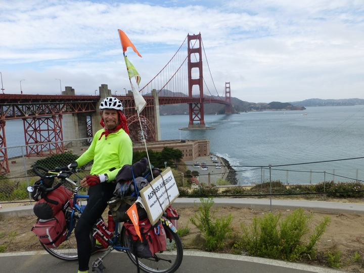 Pictured here during another tour, Frosty Wooldridge arrives at the Golden Gate Bridge a mandatory picture for any Pacific Coast bike tour.