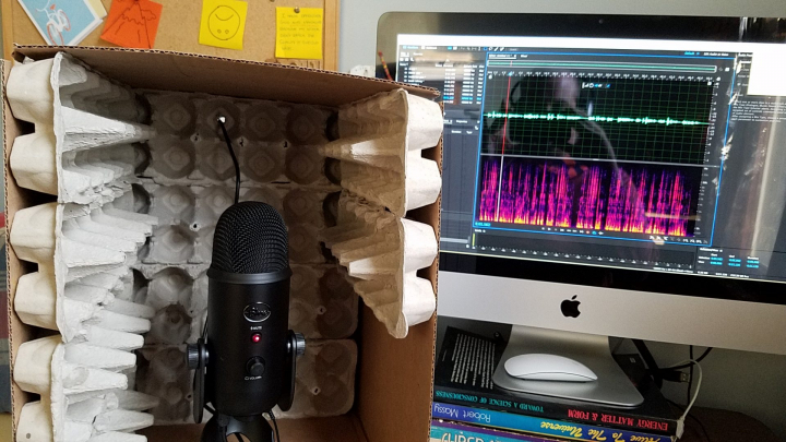 Homemade recording booth from egg cartons and cardboard box.
