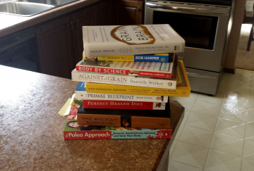 A pile of diet and fitness books. Comparing and contrasting them is the beginning of a mindfulness diet.