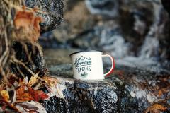 The Adventure Begins. Coffee cup in mountain stream. By Fredrick Kearney Jr