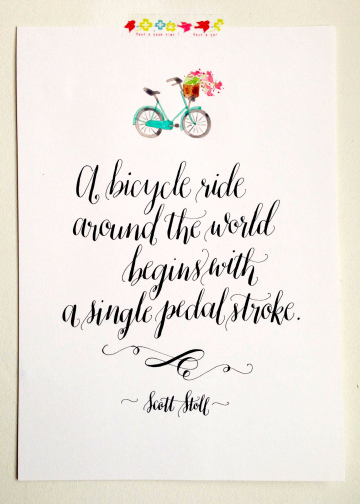A bicycle ride around the world begins with a single pedal stroke quote calligraphy