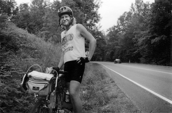 Captain Richard Suleski Junior on the side of the road with his touring bicycle.
