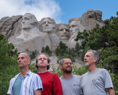 A photo of us mimicking the pose of the presidents on Mount Rushmore.
