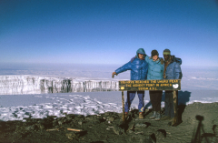Rachel Hugens and Patrick standing on Uhuru Peak, Mount Kilimanjaro, Tanzania. The highest point in Africa. 5895 meters.