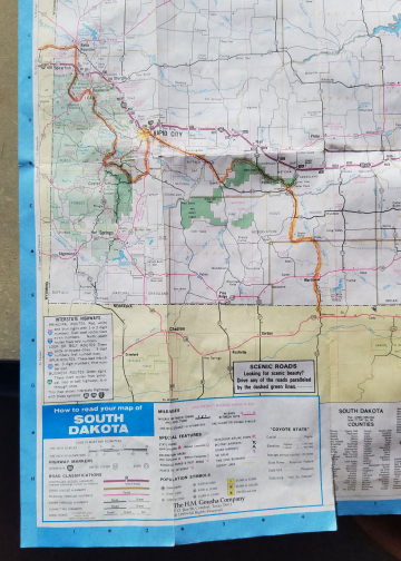 A beat up South Dakota State Map from 1997 show Scott's bicycle route highlighted in orange.