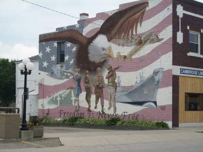 Patriotic mural with US flag and bald eagle