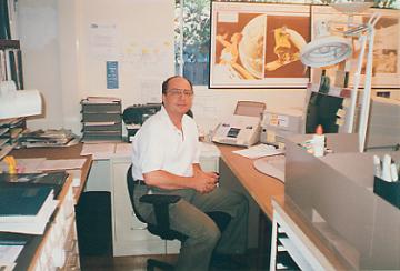 John S Spencer in his office