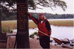 Rich stands with his paddle next to the iconic Mississippi headwaters monument.