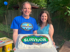 Scott Stoll's CBS Survivor audition video. This is a photo of Scott holding a cake with the Survivor logo made in frosting. He's also wearing a Survivor shirt with a logo from a different