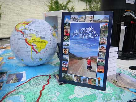 My table display for my Falling Uphill book tour with globe, maps, bookmarks, bike and more.