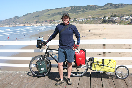 Scott Stoll book tour on a bicycle with trailer full of books