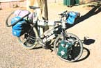 Carrying 26 liters (57 pounds) of water through the Australian Outback.